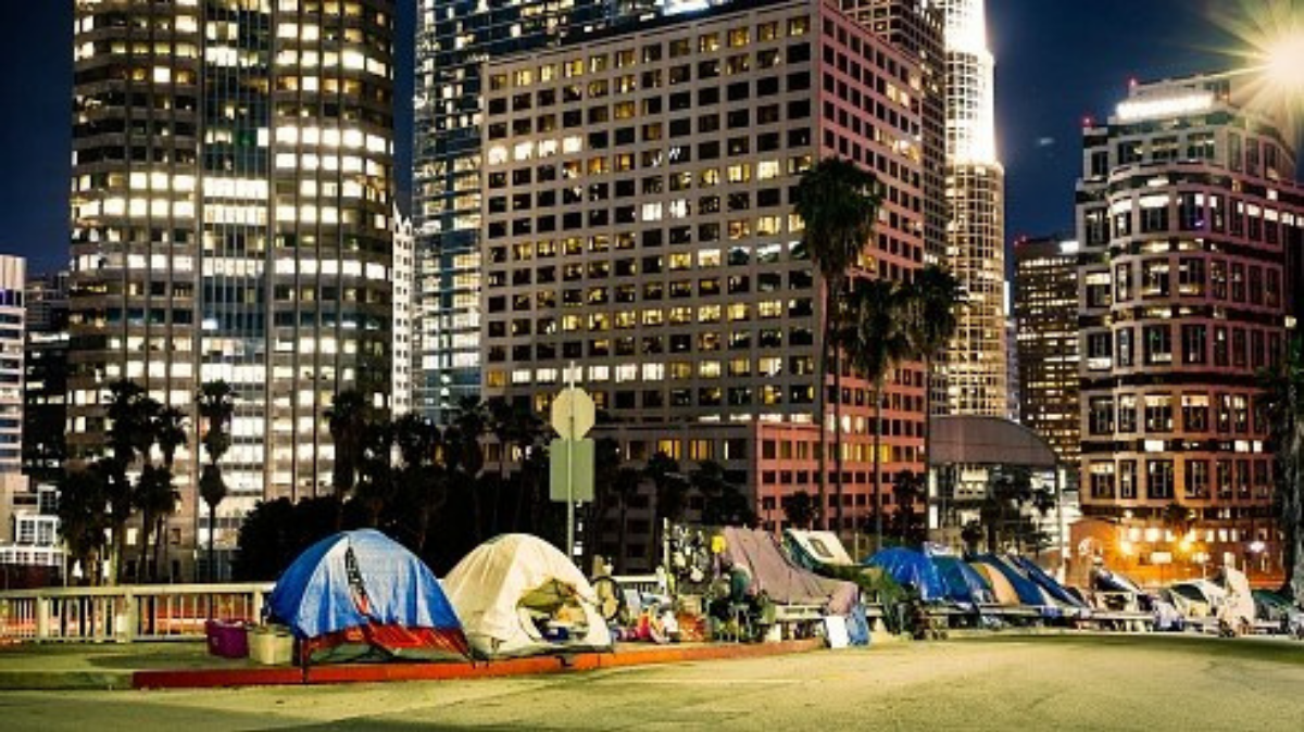 Homeless encampments line a street by the freeway in downtown Los Angeles. Mayor Eric Garcetti's spending plan for the next fiscal year includes nearly $1 billion to fight homelessness. Photo by Getty Images.