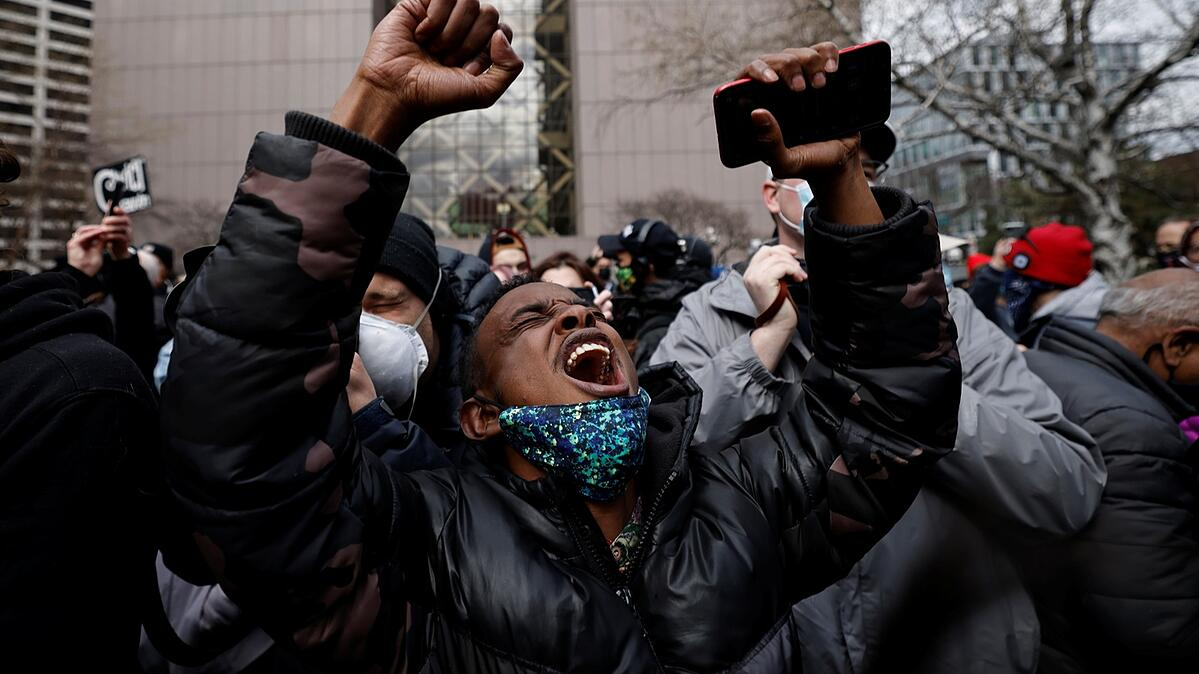 A person reacts after the verdict in the trial of former Minneapolis police officer Derek Chauvin, in the death of George Floyd, in front of Hennepin County Government Center, in Minneapolis, Minnesota, U.S., April 20, 2021. Photo by Carlos Barria/Reuters.